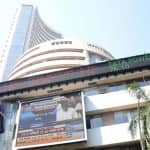 Sensex touches record high; gains 144 points in pre-noon trade