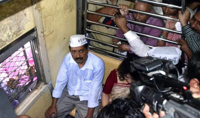 Aam-Aadmi-Party-(AAP)-leader-Arvind-Kejriwal-travels-in-a-coach-of-local-train-from-Andheri-to-Churchgate-in-Mumbai