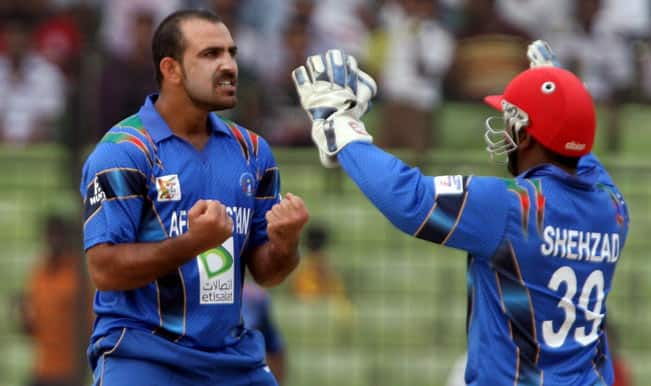 Afghani-cricketers-Mirwais-Ashraf-and-Mohammad-Shahzad-celebrate-after-fall-of-a-wicket-during-the-3rd-ODI-match-of-Asia