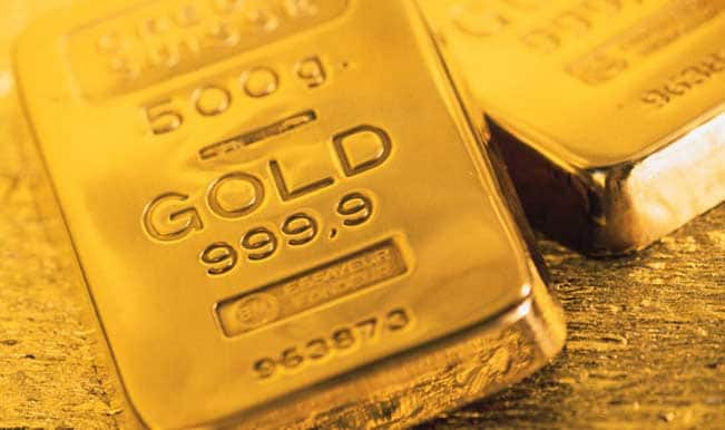 Gold falls on selling by stockists, weak global cues