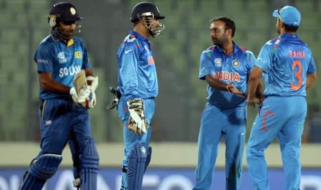 Indian-cricketers-MS-Dhoni-Amit-Mishra-and-Suresh-Raina-during-a-World-T20-w