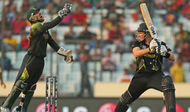 Kamran-Akmal-of-Pakistan-celebrates-after-taking-a-catch-to-dismiss-Shane-Watson-of-Australia-during-the-I