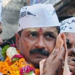 Kejriwal vows to defeat Modi, faces hostile crowd
