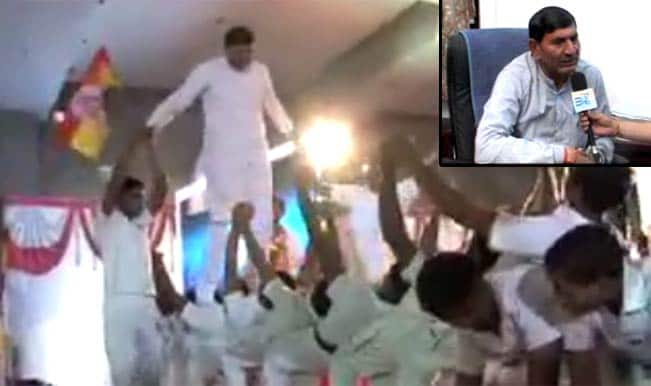 Bhartiya Janata Party's Rajkot candidate walks over children's backs