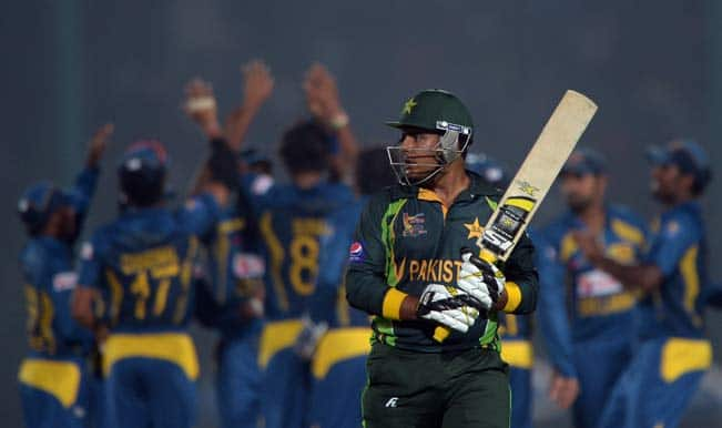 pakistani-cricketer-sharjeel-khan-reacts-after-being-given-out-as-sri-lankan-cricketers-celebrate-his-wicket-during-the-opening-match-of-the-asia-cup