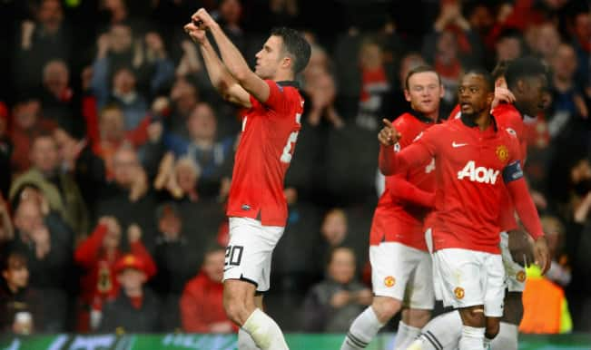 Robin van Persie hat-trick guides Manchester United to the quarter-finals of the Champions League