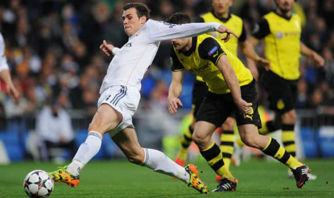 Champions League: Cristiano Ronaldo and Gareth Bale guide Real Madrid to a 3-0 win against powerless Borussia Dortmund
