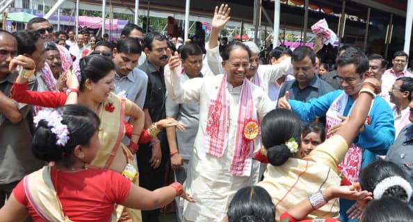 Assam Chief Minister Tarun Gogoi participates with his son Gaurav Gogoi in Rongali Bihu celebrations in Guwahati. Photo: Getty Images