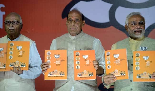 BJP prime ministerial candidate Narendra Modi with party president Rajnath Singh and senior leader Lal Krishna Advani at the BJP manifesto release. AFP