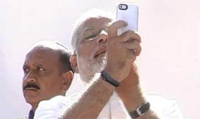 Narendra Modi poses for selfie post voting, attacks Congress' 'mother-son' government