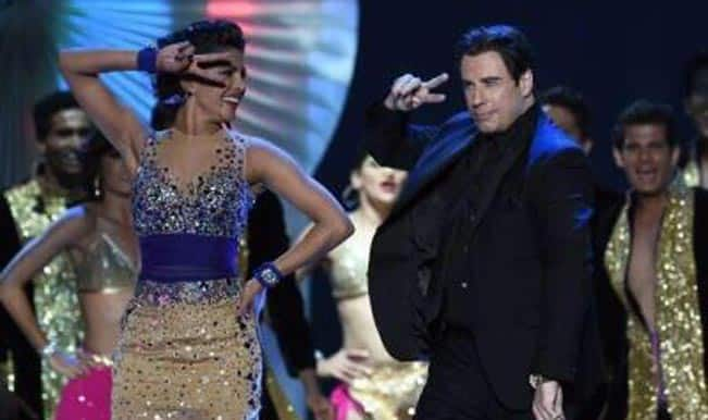 2) John Travolta dancing with Priyanka Chopra