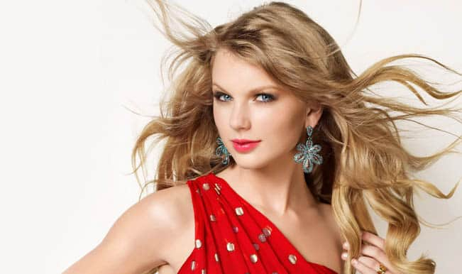 Taylor Swift surprises her super-fan by attending her bridal shower, and recording a video of it!