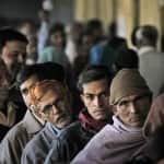 Early voters queue up outside the polling stations in Maharashtra