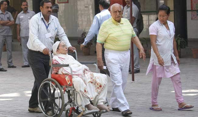 Senior citizens vote enthusiastically, helped by wheelchair