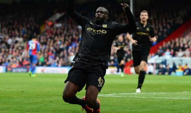 Yaya Toure magic puts Manchester City in control of EPL title race