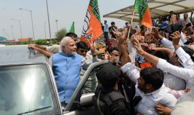 Hero's welcome for PM-elect Narendra Modi as he arrives in Delhi