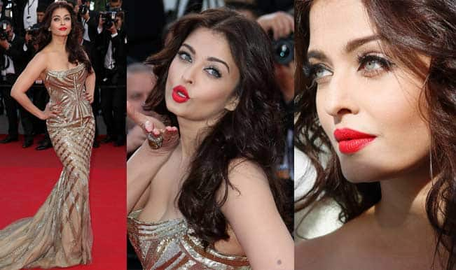 Aishwarya Rai Bachchan shines at Cannes 2014 in golden Roberto Cavalli gown