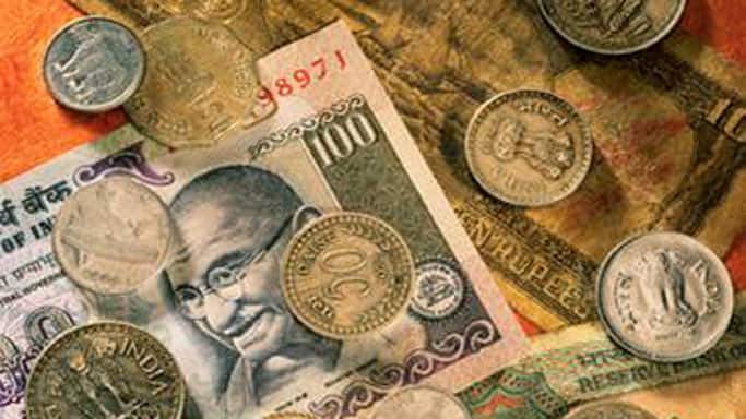 Rupee down 20 paise in morning trade