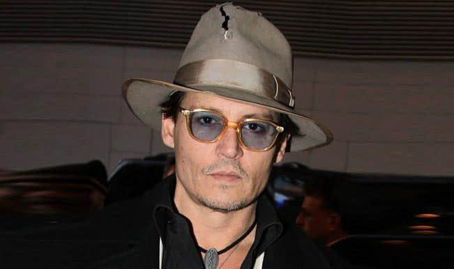 Johnny Depp punched by bodyguard!