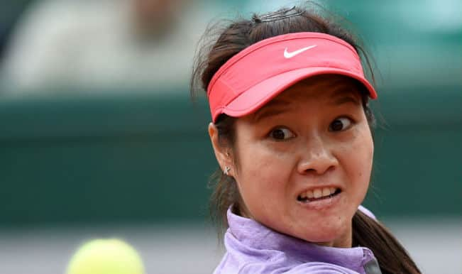 French Open 2014: Second seed Li Na stunned in the first round by Kristina Mladenovic