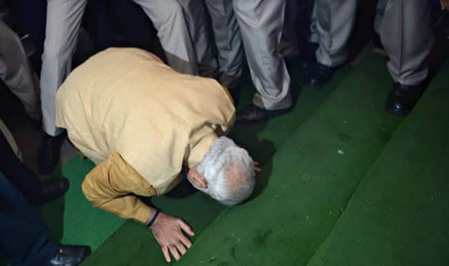Narendra Modi bows on parliament steps before entering