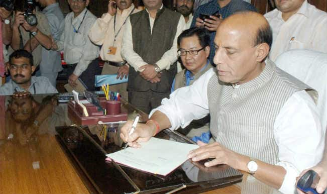 Rajnath Singh takes charge