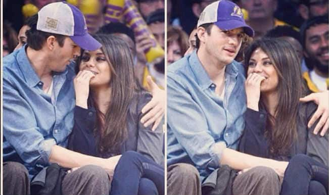 Mila Kunis and Ashtoh Kutcher cosy up at baseball game