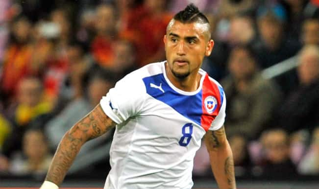 Fit-again Arturo Vidal arrives in Brazil with Chile squad