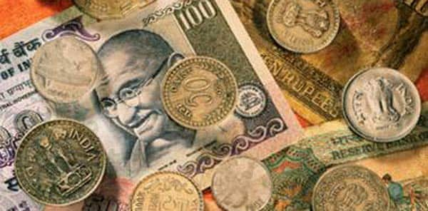 Rupee trims initial gains, still up by 14 paise Vs dollar