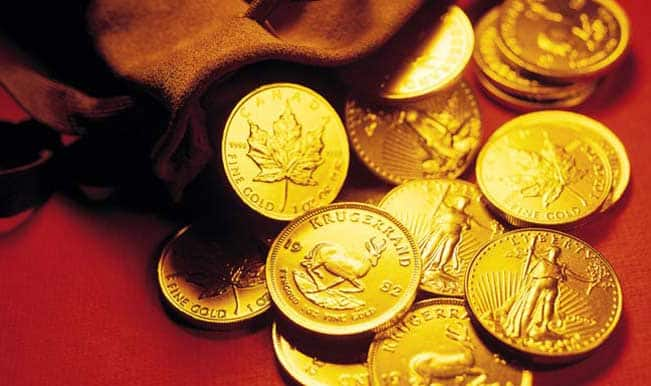 Gold futures down on global cues