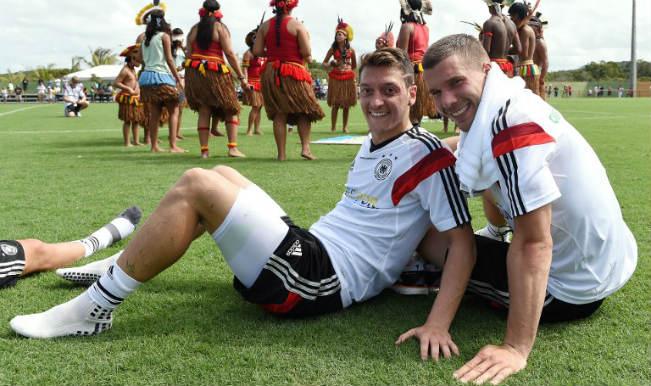 Lukas Podolski defends under-fire German teammate Mesut Ozil