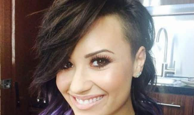 Demi Lovato shortens her hair