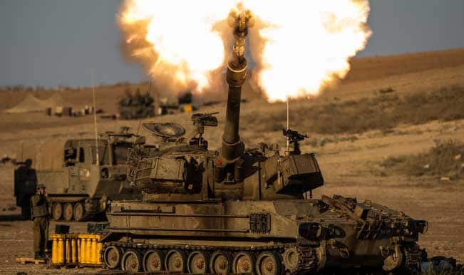 An-Israeli-self-propelled-howitzer-fires-a-shell-to-the-Gaza-Strip-in-south-Israel-bordering-the-Gaza-Strip-on