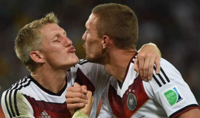 Watch Bastian Schweinsteiger and Lukas Podolski almost kiss post World Cup victory!