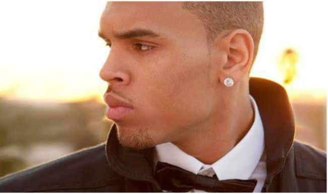 Chris Brown's neighbour threatens to shoot him!