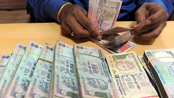 Rupee down 2 paise Vs dollar in early trade
