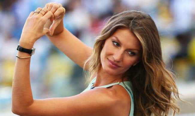Sexy Gisele Bundchen unveils FIFA World Cup 2014 trophy with Carles Puyol