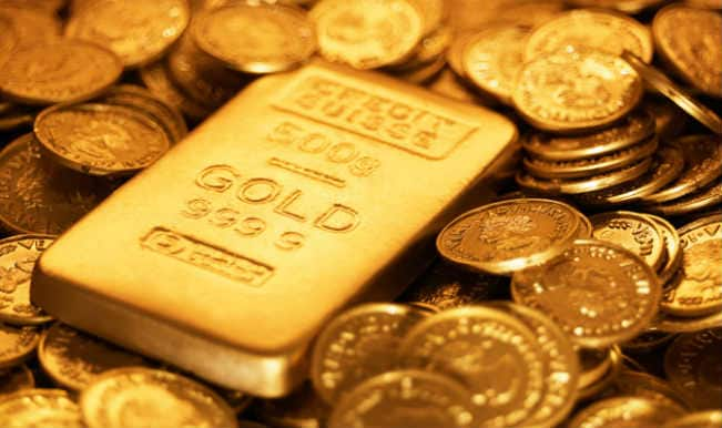 Gold futures gain on global cues