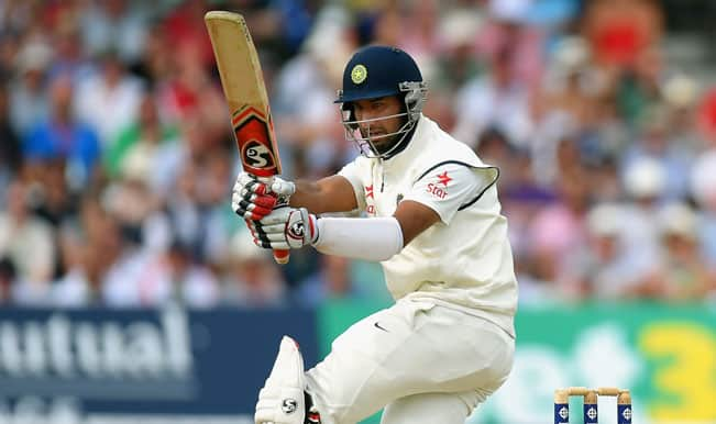 India-batsman-Cheteshwar-Pujara-pulls-a-ball-2