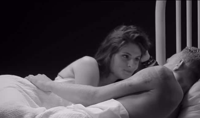 Strangers undress each other and get into bed in a sexy video