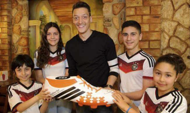 'Golden heart boy' Mesut Ozil donates World Cup bonus for 23 Brazilian kids' surgeries