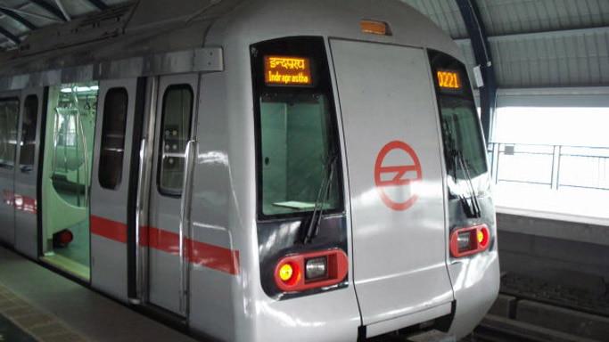 Metro train runs with doors open, operator suspended