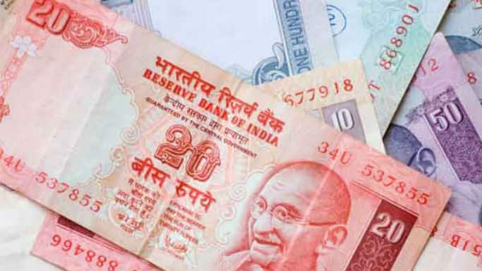 Rupee down 7 paise against dollar in morning trade