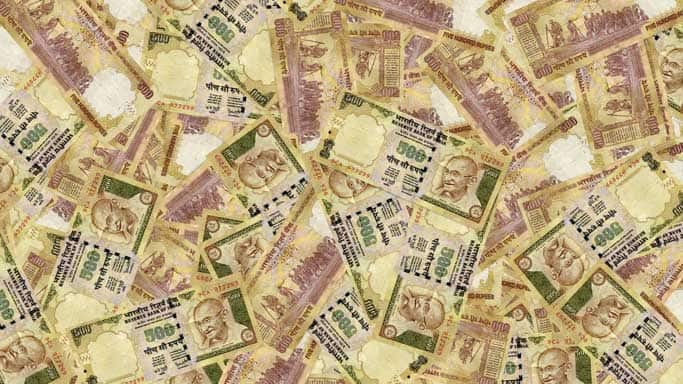 Rupee up 12 paise against dollar in early trade