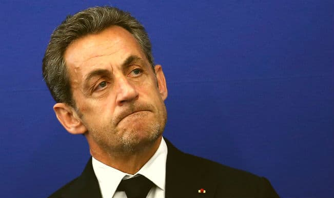 Nicolas Sarkozy held in French influence-peddling probe