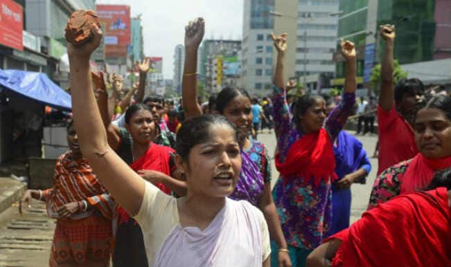 Bangladesh police tear gas garment workers on hunger strike