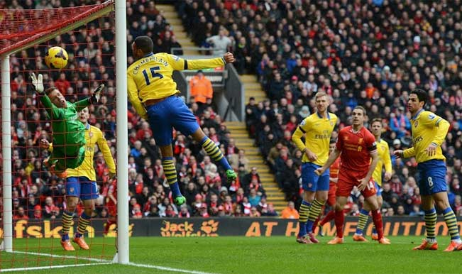 Arsenal's Alex Oxalade Chamberlain is unable to stop Liverpool's Martin Skrtel from scoring
