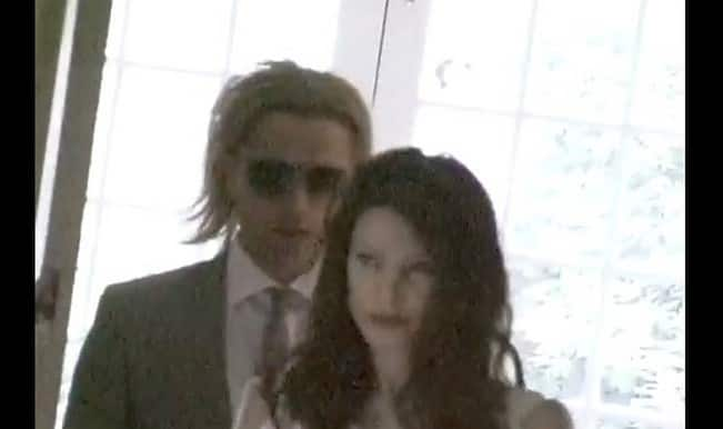 Wedding video: Angelina Jolie tries wedding gown with Brad Pitt lookalike! But is she for real?