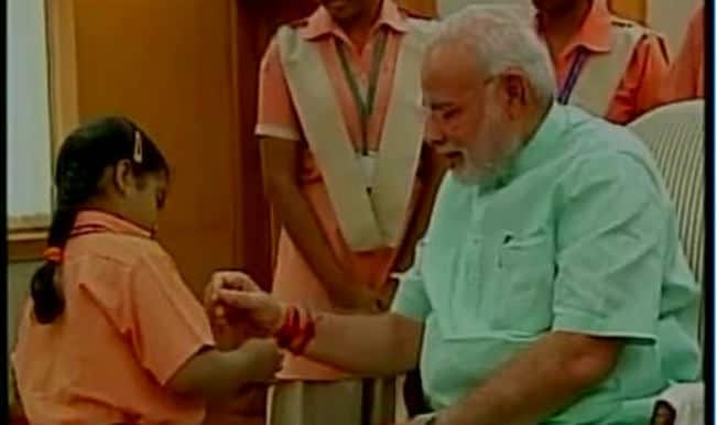 Women, children tie 'rakhi' to Narendra Modi