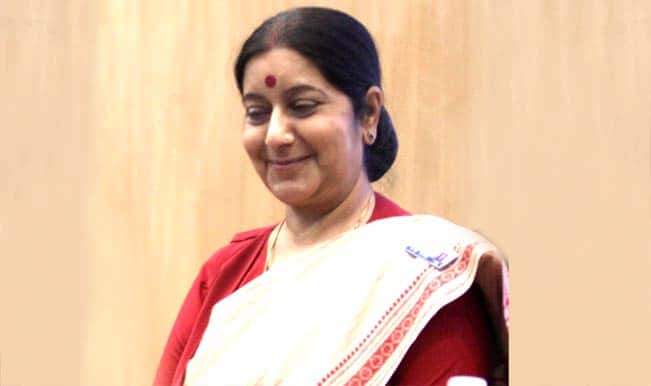 Sushma Swaraj exchanges pleasantries with Pakistan foreign official